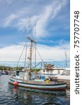 Small photo of Seattle, Washington, USA - June 25, 2014: Crab Boat Moored at Fishermen's Terminal, Port of Seattle. Vertical. Copy space. Masthead.