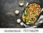 whole grain penne pasta with... | Shutterstock . vector #757736299