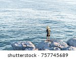 a guy is fishing with a rod on...   Shutterstock . vector #757745689