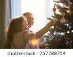 mother and daughter decorate a... | Shutterstock . vector #757788754