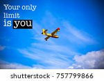 """Small photo of Inspirational motivation quote with phrase """"Your only limit is you"""", Beautiful blue sky and Firefighter Plane background"""