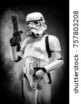 Small photo of SAN BENEDETTO DEL TRONTO, ITALY. NOVEMBER 11, 2017. Studio portrait of stormtrooper costume replica, with blaster E-11 gun. He is a fictional character of Star Wars saga. Black and white picture