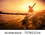 Young Surfer Rides The Wave...