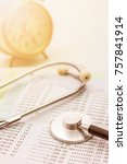 Small photo of Account book bank with stethoscope and clock in background, Financial health concept for life planning.