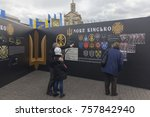 "Small photo of Kiev, Ukraine - October 30, 2017: Citizens consider historical materials on Independence Square on the anniversary of the creation of the Ukrainian army. The inscription on the plaque ""The New Army"" i"