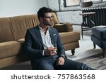 enjoying favorite drink.... | Shutterstock . vector #757863568