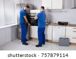 two young men in blue uniform... | Shutterstock . vector #757879114