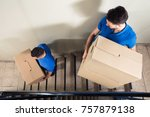 two young male movers in blue... | Shutterstock . vector #757879138