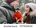 Stock photo portrait of young man and woman and their dog 757920433