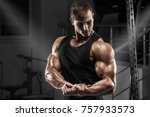 muscular man working out in gym.... | Shutterstock . vector #757933573