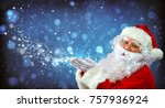 santa claus with magic light in ... | Shutterstock . vector #757936924