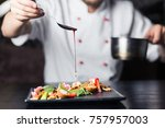 male cook serve delicious steak ... | Shutterstock . vector #757957003