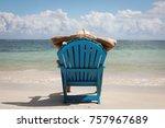 man in chair on caribbian beach | Shutterstock . vector #757967689