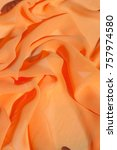 Small photo of Background texture pattern. Silk crepe of chiffon peach peachpuff Introducing the sultry and stunning Silk Satin you see here.