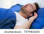 Small photo of Face close up of snoring man because of hypopnea disorder