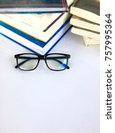 Small photo of Education concept -new and old books with glasses on white background .research information reference paper at library school