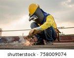 industrial welder welding... | Shutterstock . vector #758009074