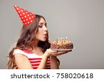 young woman blowing out candles ... | Shutterstock . vector #758020618