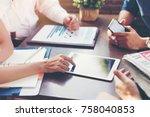 business team discusses... | Shutterstock . vector #758040853
