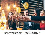 Small photo of Cheers! Friends with glasses of champagne during party celebration. New year, Birthday, Holiday Event concept