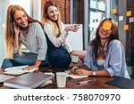 two girls laughing at their... | Shutterstock . vector #758070970