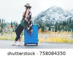 traveling woman wearing poncho... | Shutterstock . vector #758084350