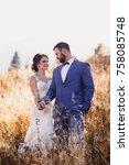 beautiful bride and groom in... | Shutterstock . vector #758085748