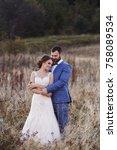beautiful bride and groom in... | Shutterstock . vector #758089534