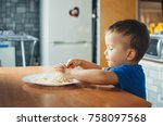 baby in the kitchen eagerly... | Shutterstock . vector #758097568