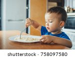 baby in the kitchen eagerly... | Shutterstock . vector #758097580