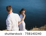 a guy and a girl are walking on ... | Shutterstock . vector #758140240