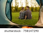 shot of a happy couple camping... | Shutterstock . vector #758147290