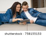 happy mother and son sitting on ... | Shutterstock . vector #758155153