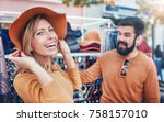 young couple buying hats and... | Shutterstock . vector #758157010