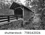 Covered Wooden Bridge With Rock ...