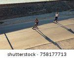 two young girls skating on the... | Shutterstock . vector #758177713