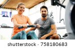 personal trainer helping | Shutterstock . vector #758180683
