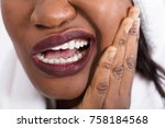 Small photo of Close-up Of An African Woman Suffering From Tooth Ache