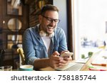 handsome businessman typing... | Shutterstock . vector #758185744