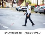 young african blind man wearing ... | Shutterstock . vector #758194960