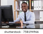 young happy businessman using... | Shutterstock . vector #758194966
