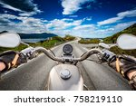 biker rides a road with... | Shutterstock . vector #758219110