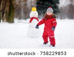 little boy in red winter... | Shutterstock . vector #758229853