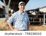 breeder in front of his cows | Shutterstock . vector #758238310