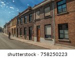 Cyclist And Brick Facade Of Old ...