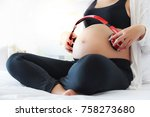 a beautiful pregnant puts the... | Shutterstock . vector #758273680