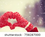 heart of mittens in snow.... | Shutterstock . vector #758287000