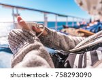 Cup of Coffee on the Cruise Ship Deckchair During Ocean Crossing. Woman Wearing Sweater Holding White Cup of Coffee in Hand. - stock photo