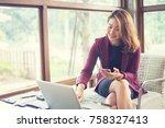 business woman holding smart... | Shutterstock . vector #758327413