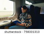 woman traveling by train... | Shutterstock . vector #758331313
